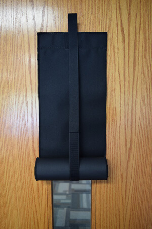 Lockdown shade extension strap